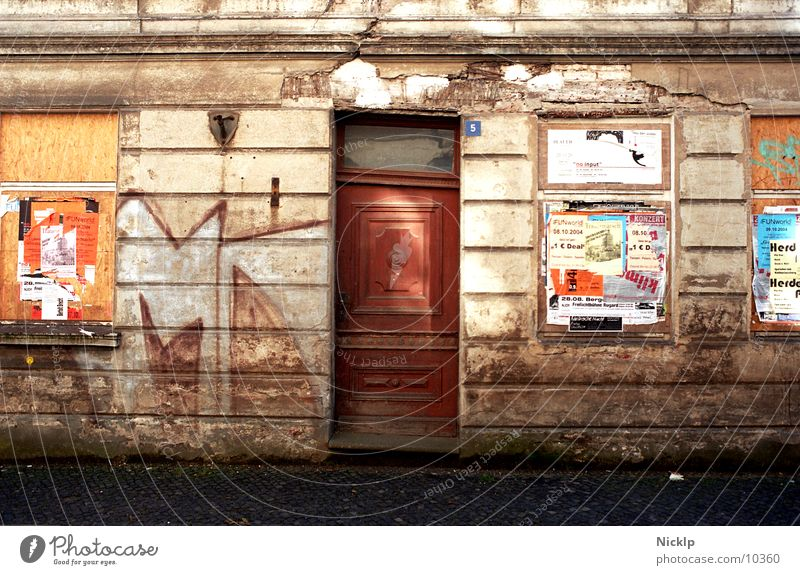 Old House (Residential Structure) Window Wall (building) Graffiti Autumn Wall (barrier) Time Facade Dirty Door Transience Beautiful weather Culture Adventure