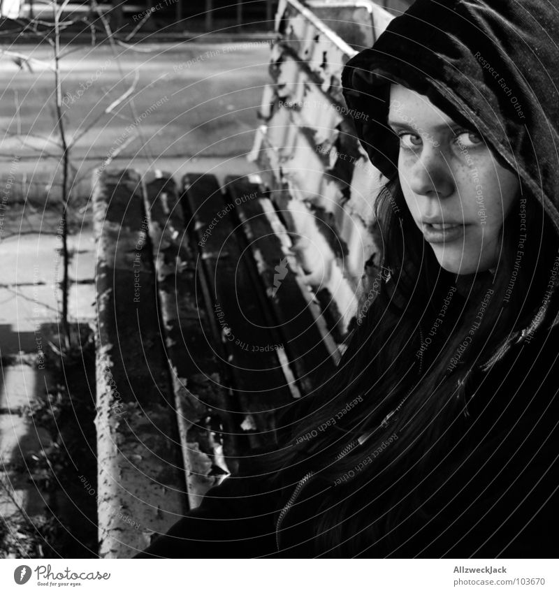 wait on the bench Lateness Grass Tree Woman Girl Seating Meeting Sit down Long Hooded (clothing) Coat Black White Train station Boredom Wait uncontrolled growth