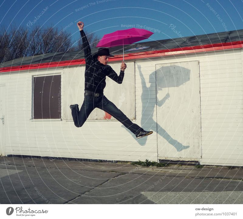 now but quickly - young man sporty with umbrella swift hurry up now Man Athletic Jump Hop Umbrellas & Shades Sunshade Human being Joy Adults Day Colour photo