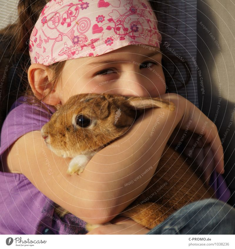 Girl cuddles with rabbit Feminine Child girl Infancy 1 Human being 3 - 8 years Headwear Headscarf Pet Hare & Rabbit & Bunny Animal Touch Kissing Love Sit Cute