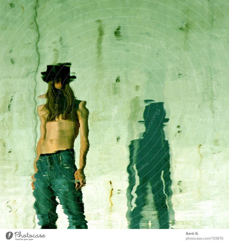 stand by Stand Reflection Calm Grow hazy Distorted Pants Green Man Young man Upper body Stomach Top hat Hair and hairstyles Long-haired Faceless Green undertone