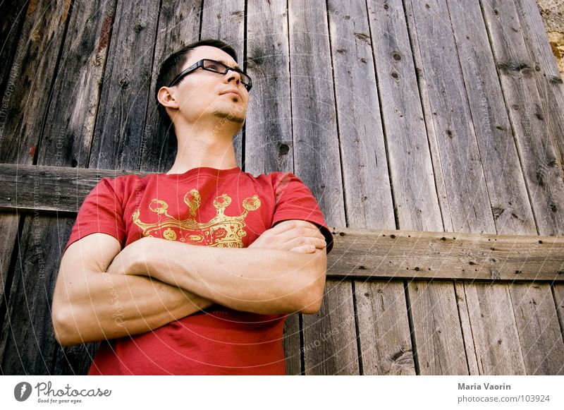 Level only looks like arrogance from below Arrogant Red T-shirt Calm Dismissive Man Masculine Worm's-eye view Eyeglasses Person wearing glasses Gate Wood