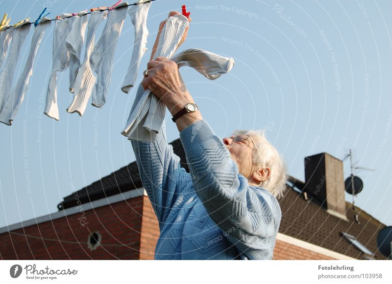 grandma at the laundry Work and employment Grandmother Stockings Old Time Laundry Action Household laundry line background house Senior citizen Female senior