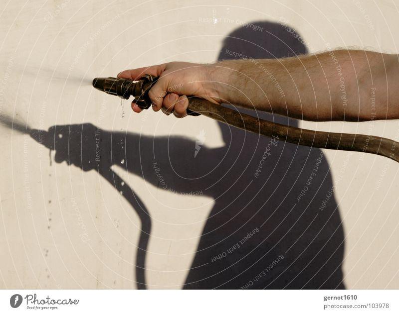 Human being Man Hand Water Summer Joy Dark Warmth Skin Arm Blaze Wet Drops of water Fingers Physics