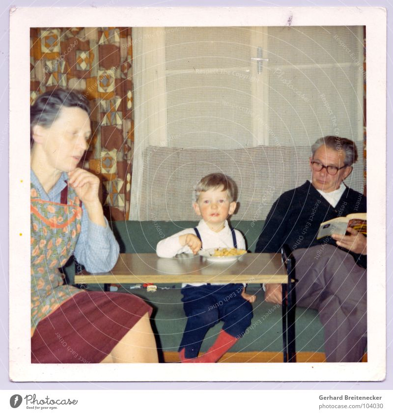 Human being Child Old Nutrition Life Boy (child) Family & Relations Together Sit Retro Peace Idyll Grandmother Living room Grandfather Nostalgia