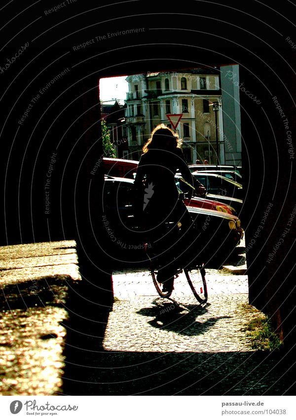 Around the corner Passau Bicycle Light University & College student Woman Cycling Traffic infrastructure Shadow Cobblestones