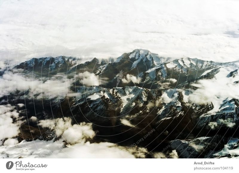 Alps Bird's-eye view Aerial photograph Airplane Glacier Clouds Bad weather Cloud cover Flying Winter Mountain Switzerland Ice Sky Landscape Stone Rock Fragment