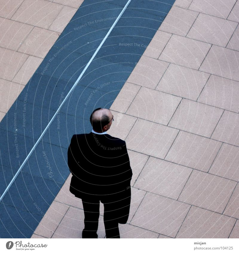 Human being Man Blue Loneliness Black Hair and hairstyles Style Stone Legs Business Work and employment Back Wait Masculine Perspective Stand