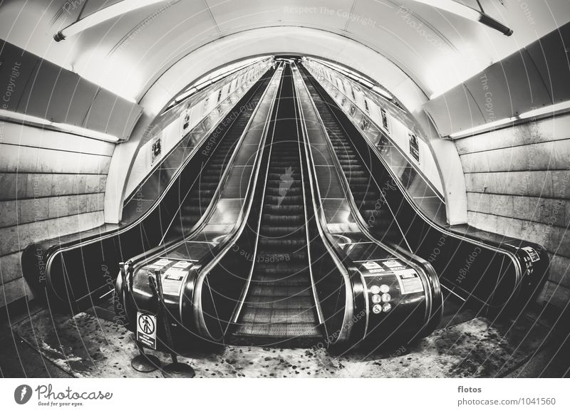 Stairway to ... Town Deserted Train station Tunnel Manmade structures Stairs Public transit Gray Black White Loneliness Escalator Black & white photo