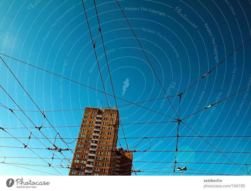 Sky Blue House (Residential Structure) Window Architecture High-rise Railroad Facade Perspective Energy industry Arrangement Electricity Net Connection Story