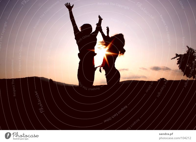 Jump up! Sunset Evening Man Woman Dark Sunbeam Silhouette Twilight Violet Pink Clouds Celestial bodies and the universe Earth Sand Dusk Human being Shadow Tall