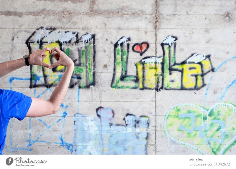 young man in love forms a heart with his hands Human being Masculine Young man Youth (Young adults) Man Adults Life Hand Fingers 1 30 - 45 years Wall (barrier)