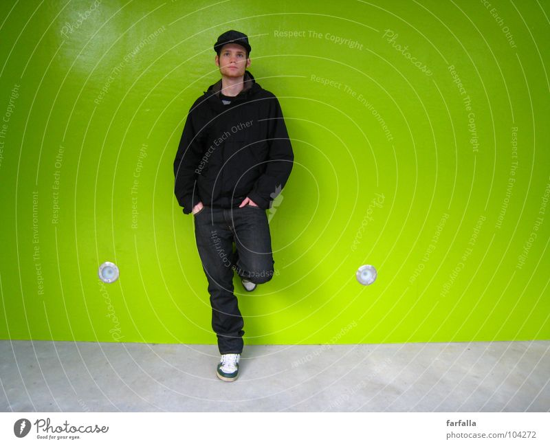 Man Green Wall (building) Wait Stand Station Guy Fellow Human being Lean Gaudy