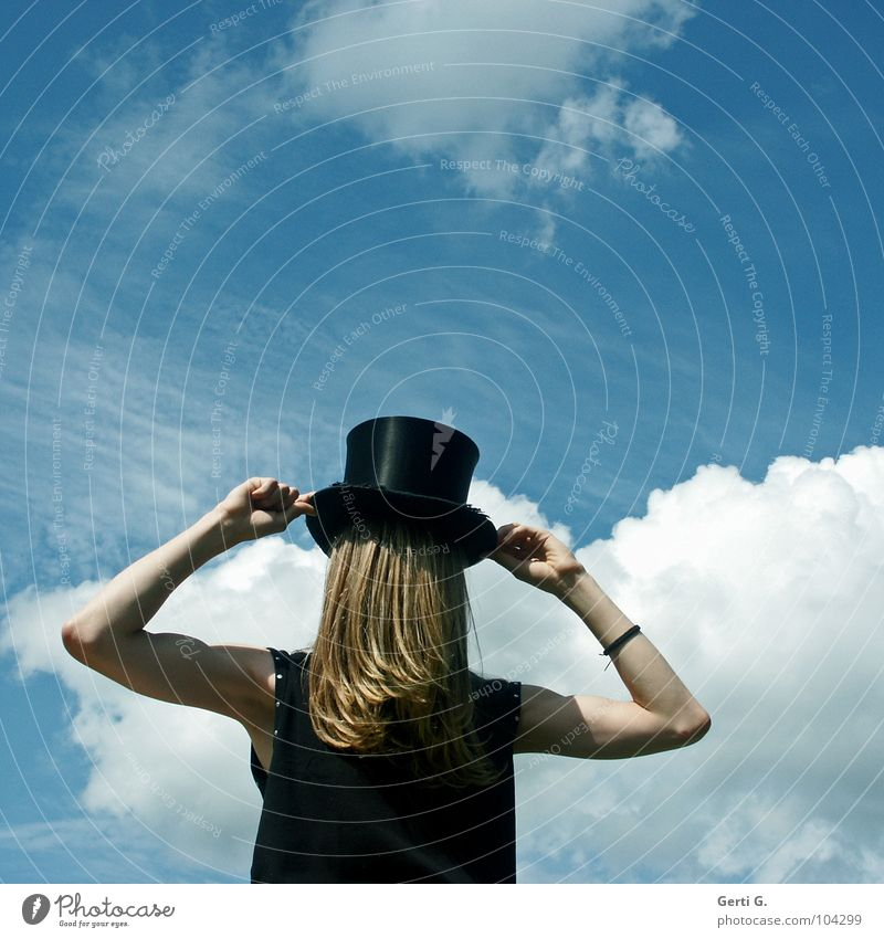magic has Surrealism False Inverted Man Long-haired Blonde Headwear Camouflage Concealed Invisible Really Mystic Absurd Fantastic Shirt Black Sky blue Clouds