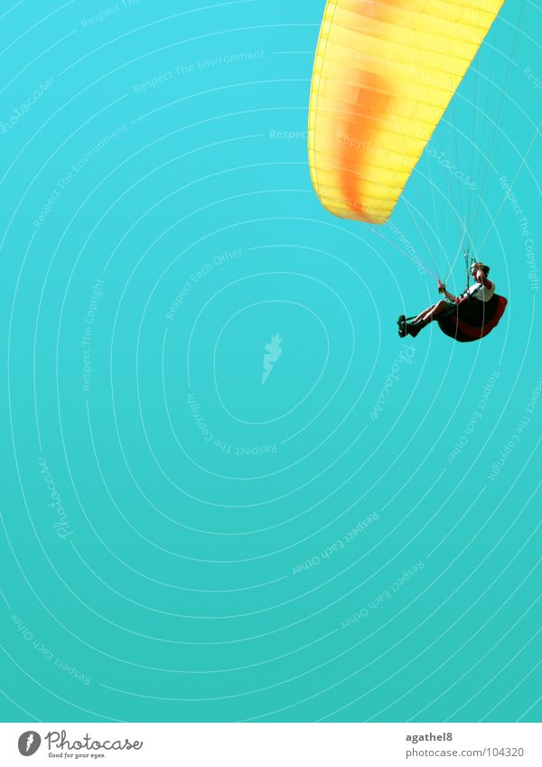 Flying around the corner Paragliding Yellow Glide Cyan Helmet Extreme sports Sky Tall Blue