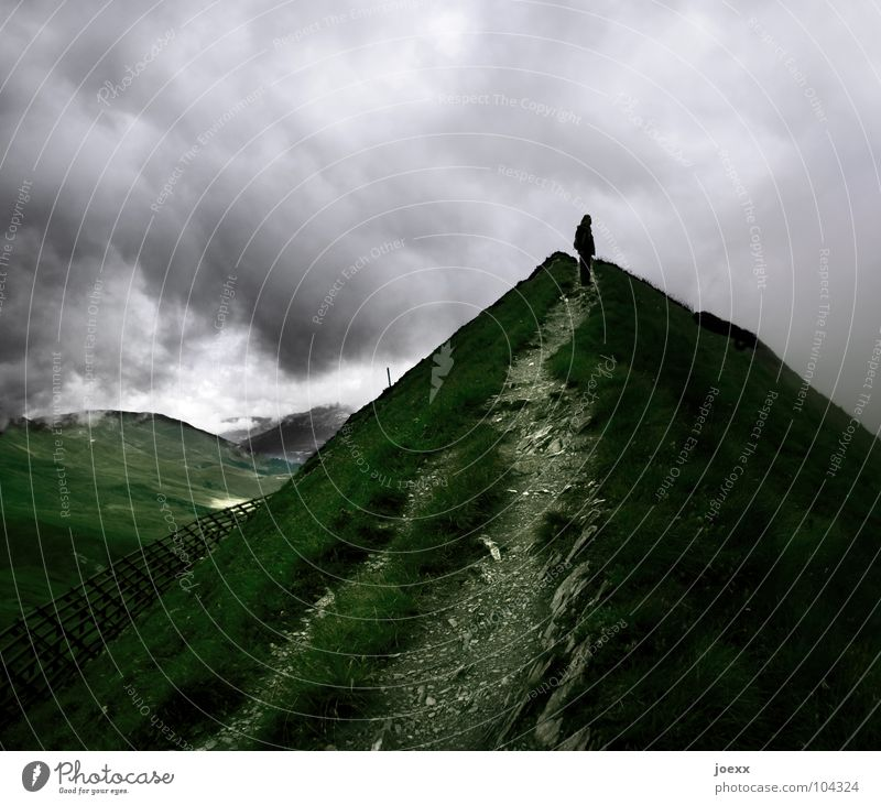 Human being Sky Man Clouds Loneliness Dark Cold Mountain Above Lanes & trails Rain Wind Hiking Success Point Target