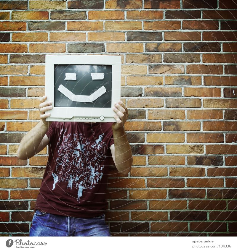 Man Joy Wall (building) Information Technology Laughter Stone Funny Computer Crazy Human being Brick Screen Whimsical Hide Grinning Freak