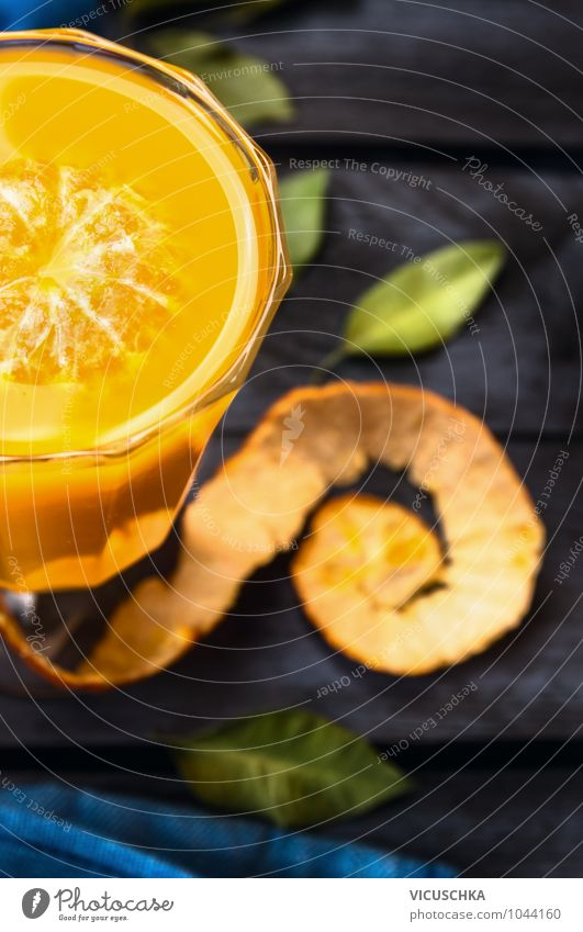 Citrus juice in a glass on a dark table Beverage Juice Glass Style Design Restaurant Nature Retro Vintage Vitamin Citrus fruits Leaf Table Healthy Eating