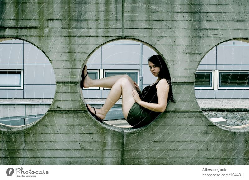 right in the middle Concrete Wall (building) Circle Hollow Round Wall (barrier) Cement Gray Woman 3 Middle Modern Boredom Sit Wait Relaxation Detail