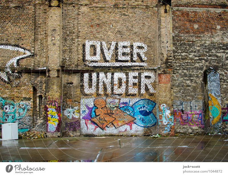 Division over and under Icebox Subculture Street art Typography Prenzlauer Berg Parking lot Wall (barrier) Wall (building) Brick Graffiti Word Dirty Sharp-edged