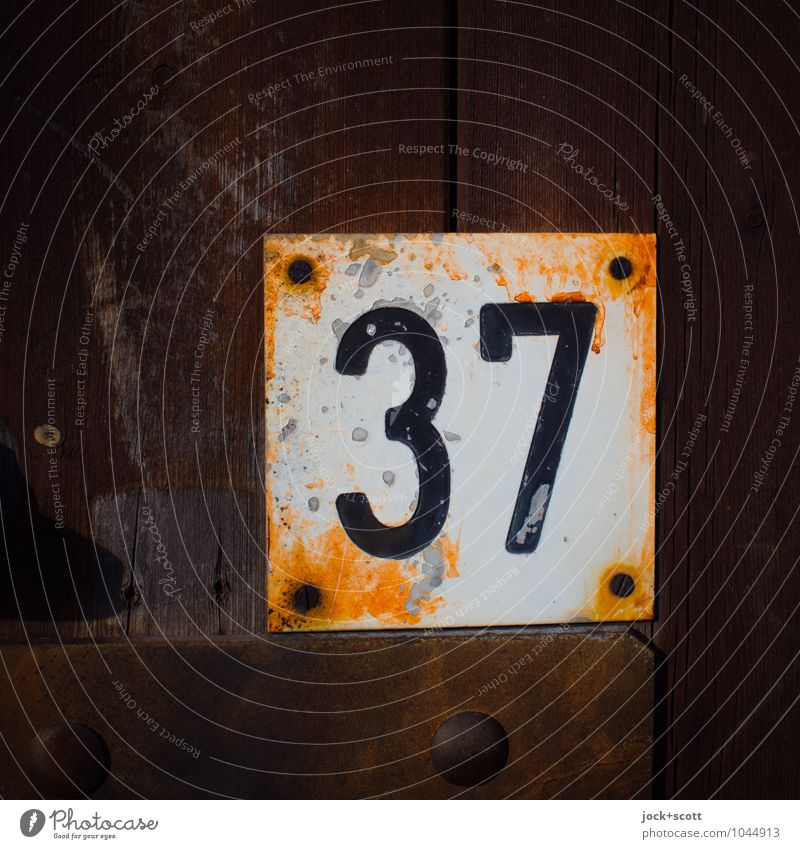 37 six times six plus one Typography Wood Metal Rust Digits and numbers Signs and labeling Square Old Retro Brown Transience Change Weathered Screw Embossing