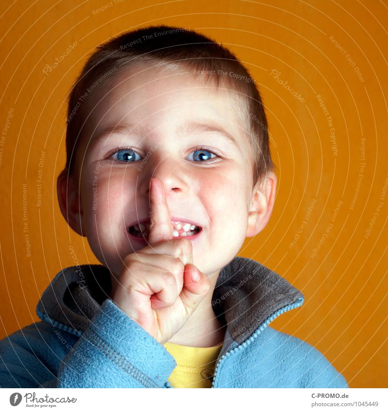 PSSSSSSSSST.... Child Boy (child) Head Eyes Mouth Fingers 1 Human being 1 - 3 years Toddler 3 - 8 years Infancy Sweater Blue Yellow Secrecy Disciplined
