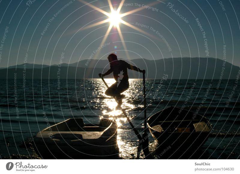 Man Sun Joy Beach Vacation & Travel Dark Jump Mountain Freedom Happy Lake Watercraft Bright Background picture Happiness