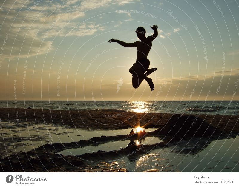beach jumping Ocean Beach Action Sunset Exterior shot Summer Departure Joie de vivre (Vitality) Jump Aloof Vacation & Travel Leisure and hobbies Free Lake