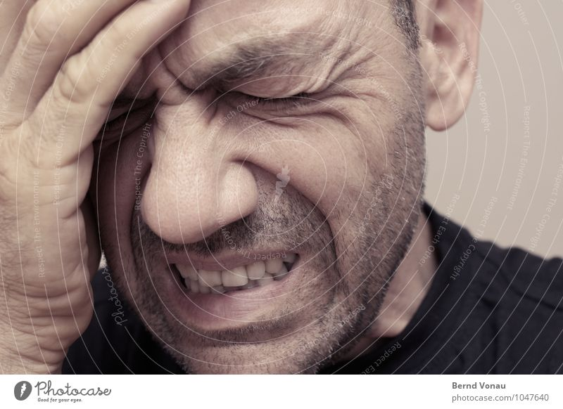 headache Human being Masculine Man Adults Head Face Fingers 1 45 - 60 years Brown Headache To hold on Furrowed brow Wrinkle Designer stubble Show your teeth