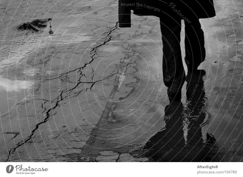 walking after the rain Promenade Barcelona Grief Distress Black & white photo Water man reflected loneliness sad sadness alone black