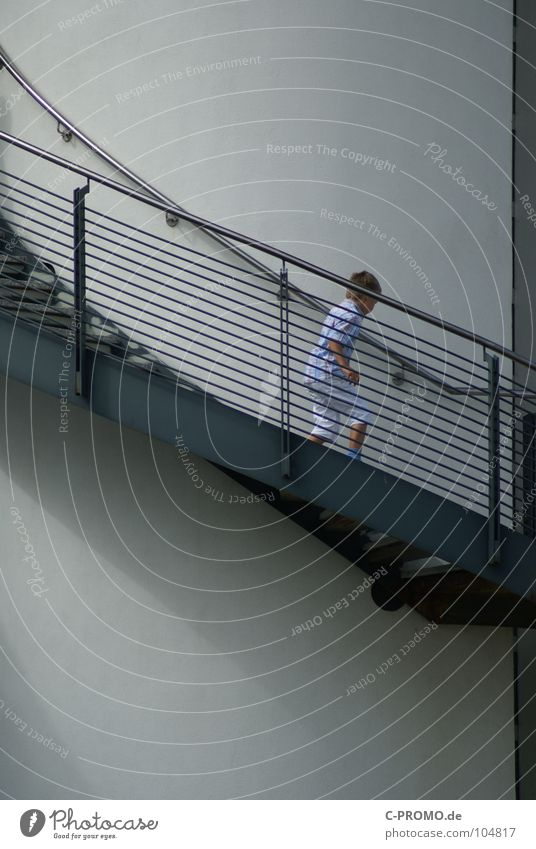 Child Boy (child) Walking Tall Stairs Modern Tower Toddler Handrail Upward Downward Winding staircase