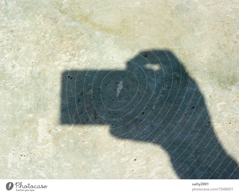 clipping Camera Hand Fingers Small Take a photo Release Stone floor Shadow play To hold on Silhouette Sharp-edged Colour photo Exterior shot Deserted Day