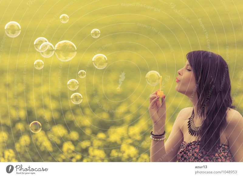 Beautiful woman blowing many soap bubbles in summer nature Lifestyle Healthy Alternative medicine Wellness Harmonious Contentment Senses Relaxation Calm