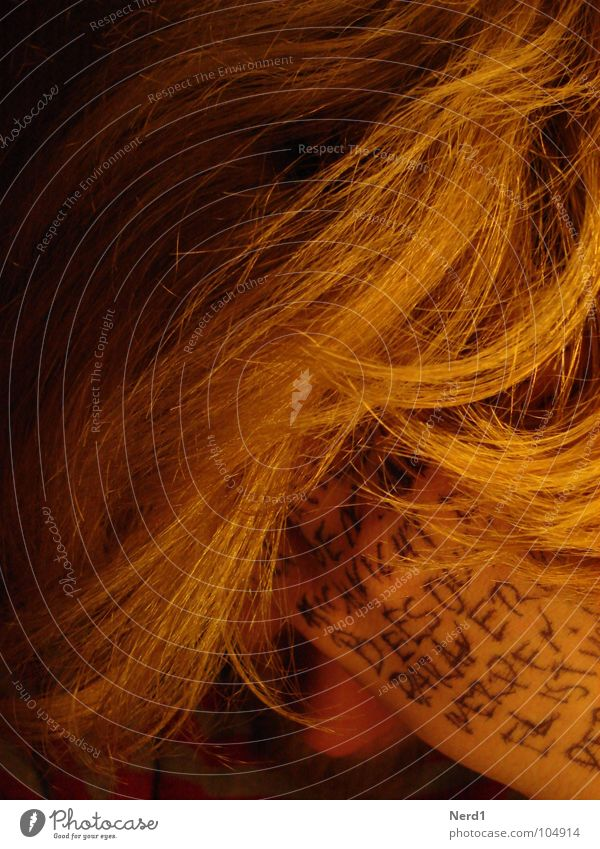 Man Hand Yellow Dark Hair and hairstyles Blonde Characters Text Section of image Partially visible Strand of hair Capital letter Handwritten Latin script
