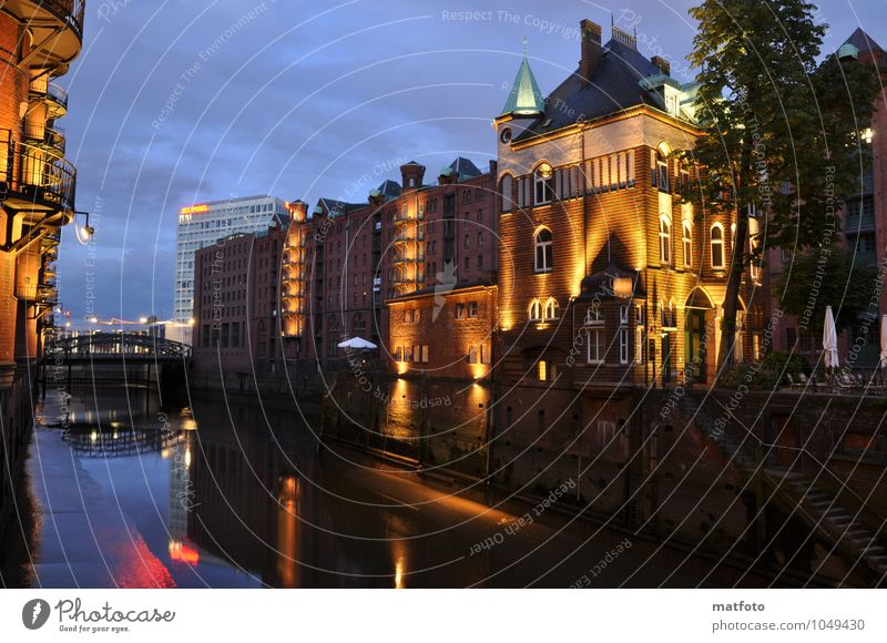 Hamburg Speicherstadt at night 4 Water Sky Night sky Tourist Attraction Landmark Moated castle Inland navigation Harbour Old Blue Yellow Nostalgia Colour photo