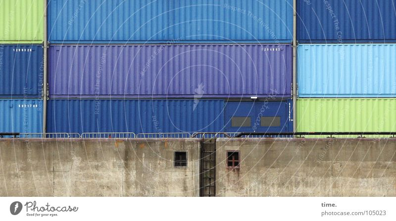 Biscuit tins XXXXXXXL Colour photo Exterior shot Day Ocean Industry Logistics Harbour Wall (barrier) Wall (building) Watercraft Container Packaging Tin Stone