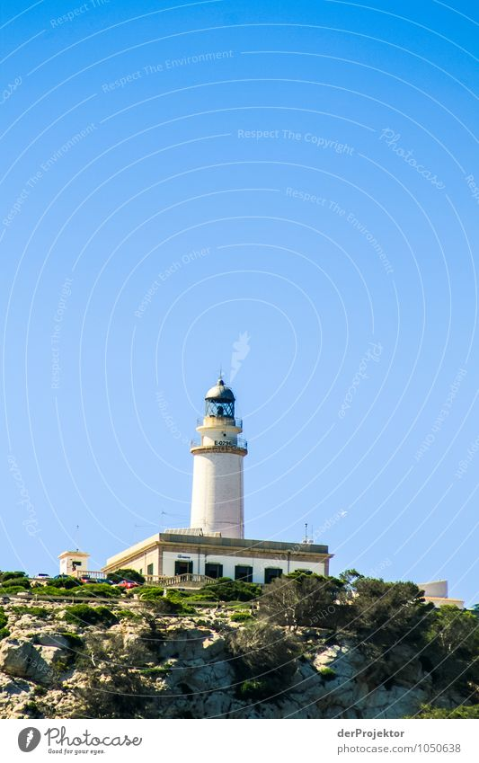 Lighthouse seen from the sea Vacation & Travel Tourism Trip Far-off places Freedom Summer vacation Mountain Environment Nature Landscape Plant Animal Hill Rock