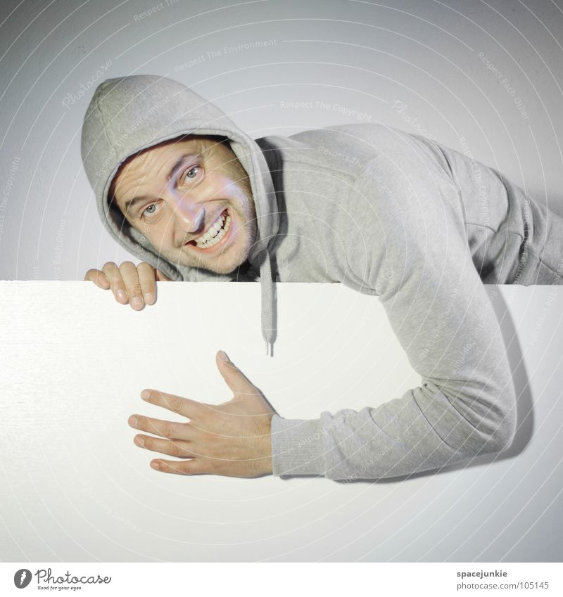 You're not happy. Man Portrait photograph Funny Humor Whimsical Surprise Cosmetic change Futile Sweater Wall (building) White Madness Crazy Joy Hiding place