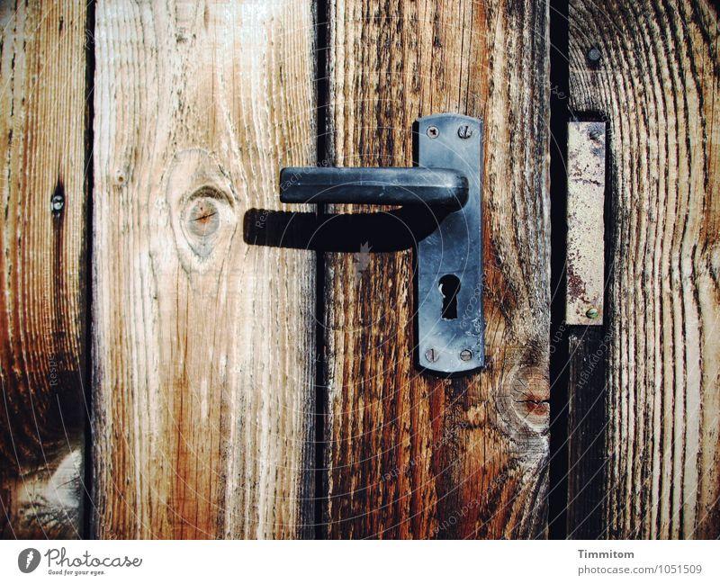 I was promised a castle, a place to stay. Hut Door Door lock Door handle Metal fitting Screw Wood Wait Dark Simple Brown Black Emotions Wood grain Shadow Closed