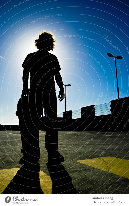 Skateboarding is not a crime - Pt.I Man Back-light Yellow Lantern Parking Parking garage Stand Threat Grating Fence Parking lot Sky Portrait photograph Bans