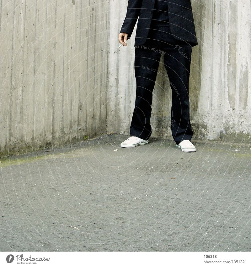 Man Black Legs Corner Smoking Suit Cigarette Sneakers Backyard Anonymous Section of image Partially visible Headless Isolated (Position) Schoolyard Faceless