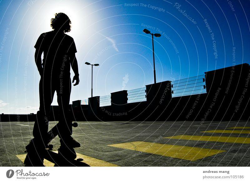 Human being Sky Man Blue Yellow Stand Cool (slang) Stripe Threat Lantern Fence Skateboarding Parking Bans Parking lot Grating