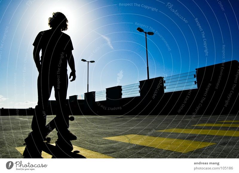 Skateboarding is not a crime - Pt.II Man Back-light Yellow Lantern Parking Parking garage Stand Threat Grating Fence Parking lot Sky Portrait photograph Bans