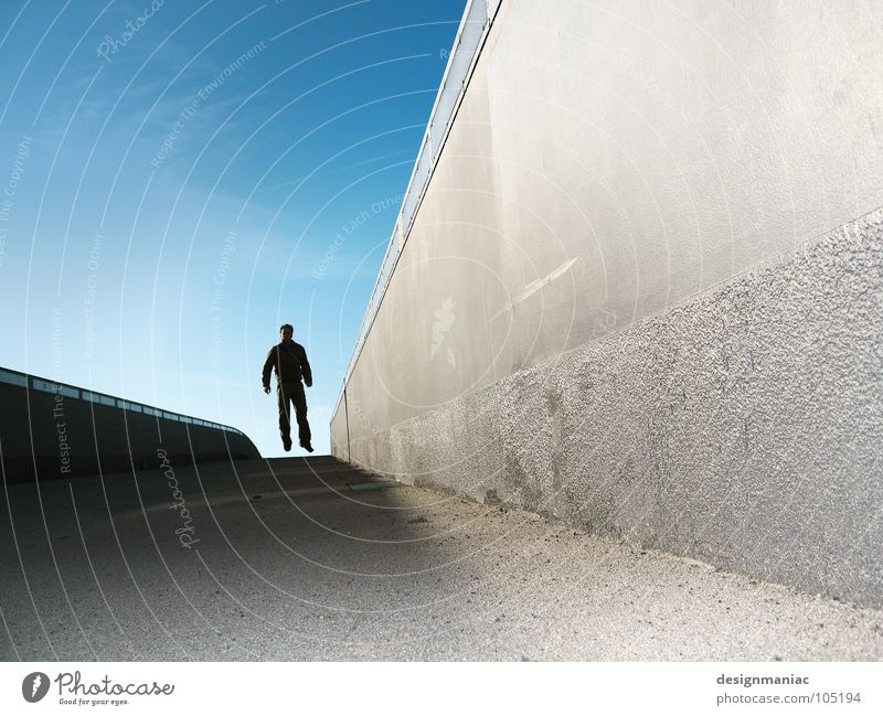 Gonna fly now (Juhuu 100) Matrix Style Extreme Concrete Gray Black Man Jump Hover Air Weightlessness Dark Hero Steep Stock market Vanishing point