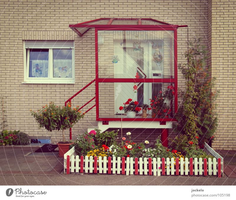 private House (Residential Structure) Front garden Entrance Door Red Swabian Fence Garden fence White Reddish white Bushes Petit bourgeois Town Colour error