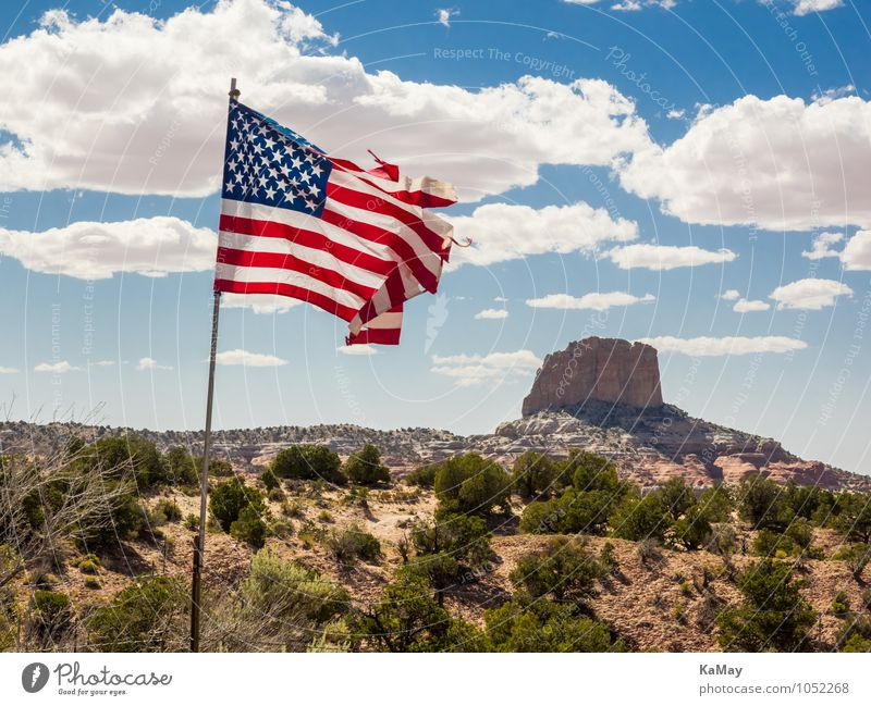 patriotic hillock Nature Landscape Earth Sky Clouds Summer Beautiful weather Bushes Rock Deserted Tourist Attraction Landmark Stone Sand Flag Natural Blue Brown