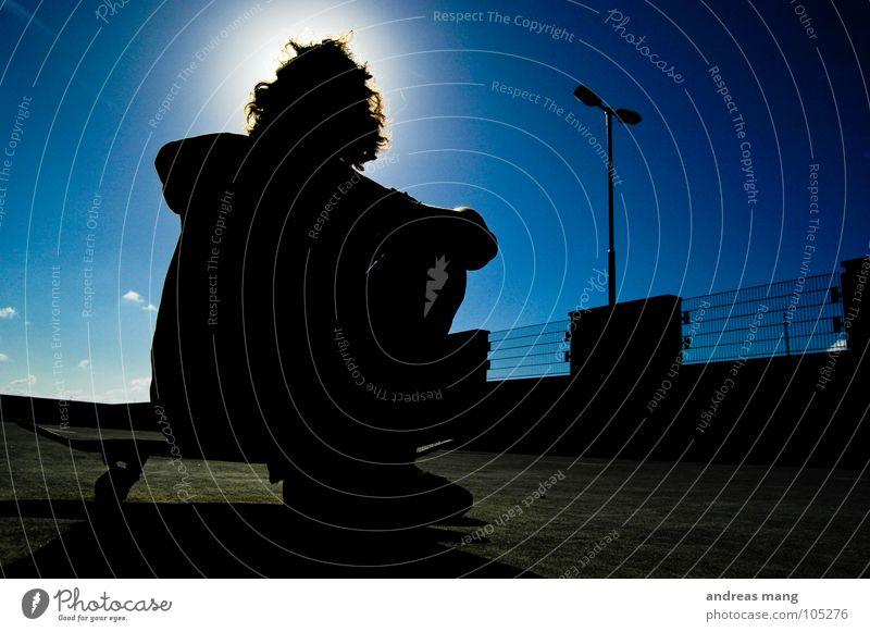 Human being Sky Man Blue Calm Relaxation Yellow Sit Cool (slang) Threat Lantern Fence To enjoy Skateboarding Parking Bans