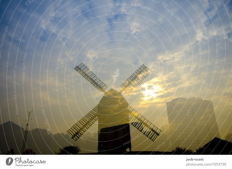 Shot & Grain in Marzahn Clouds spring Climate change Beautiful weather High-rise Windmill Illuminate Fantastic Positive Moody Contentment Idyll Surrealism