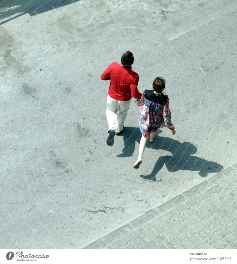 Woman Human being Man Joy Love Street Gray Happy Family & Relations 2 Together Walking Concrete Bird's-eye view Partner