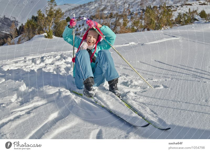 Young girl lifts up after the fall at Nordic ski resort Human being Child Nature Vacation & Travel Youth (Young adults) White Young woman Relaxation Red Joy